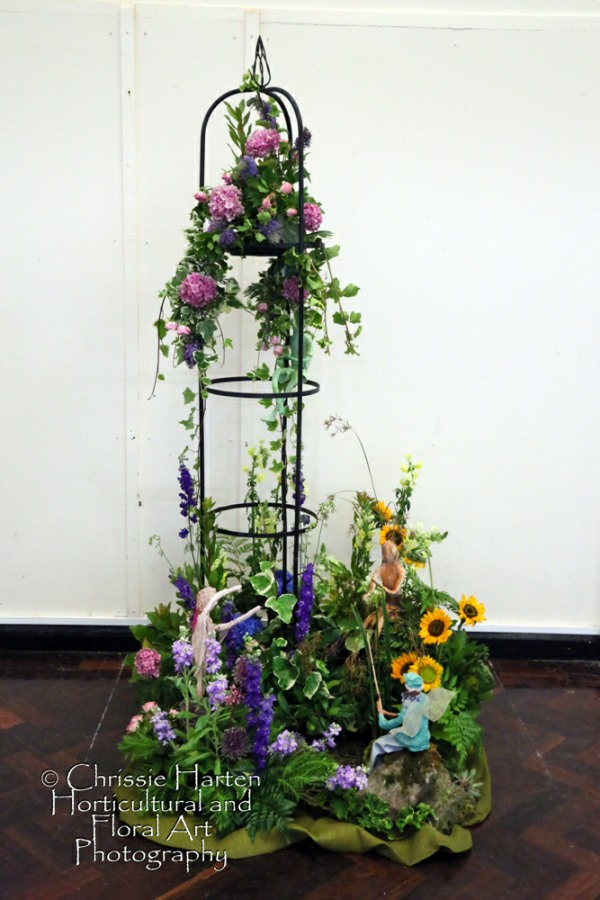 """Summer Magic"" (Club Class) - 3rd - Bromyard Flower Club (Brigette Manton & Heather Nuthall)"